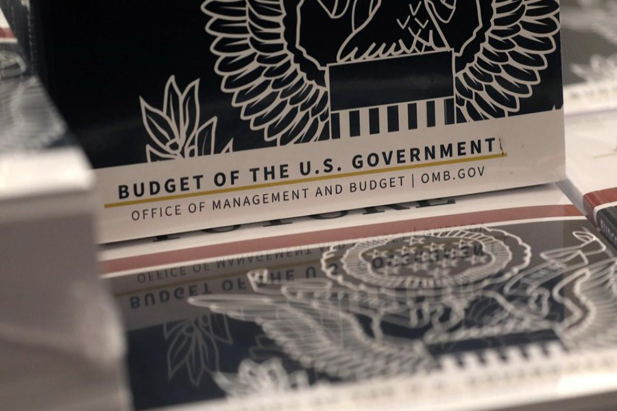 Copies of US president Donald Trump's FY2021 budget proposal sit on display for the news media on Capitol Hill in Washington, US, February 10, 2020. Reuters