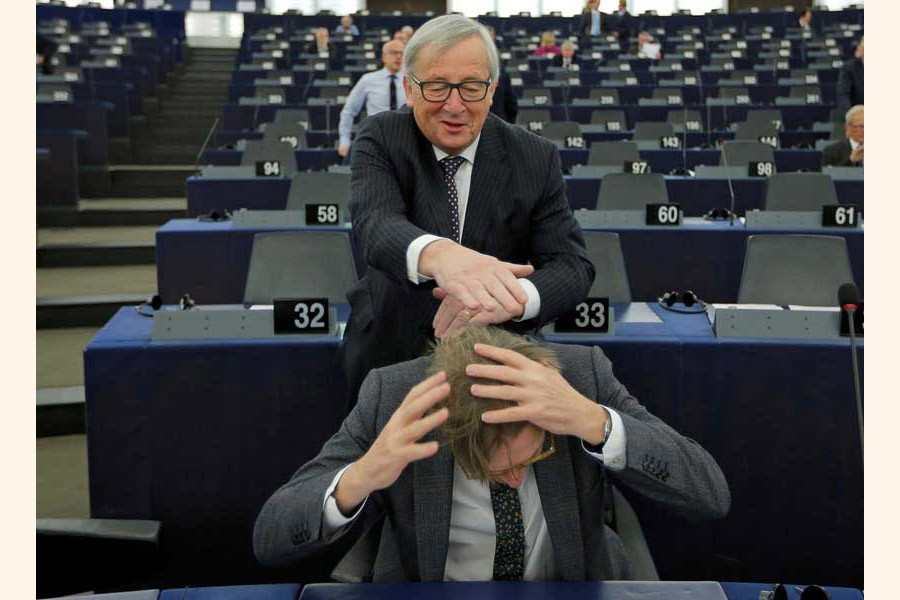 European Commission President Jean-Claude Juncker jokes with European Union's chief Brexit negotiator Guy Verhofstadt ahead of a debate on the Future of Europe at the European Parliament in Strasbourg, France on February 06, 2018.  —Reuters