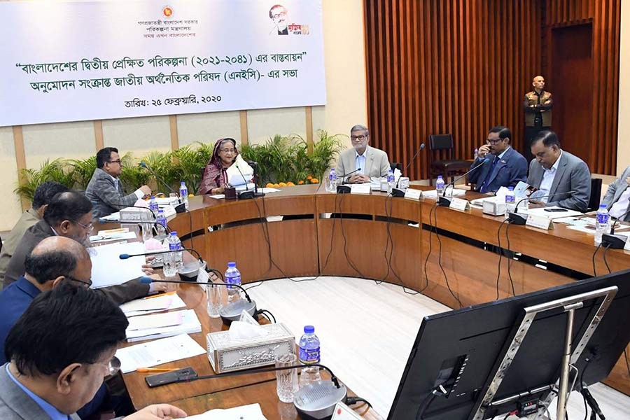 Prime Minister Sheikh Hasina presiding over the NEC meeting on Tuesday. -PID Photo
