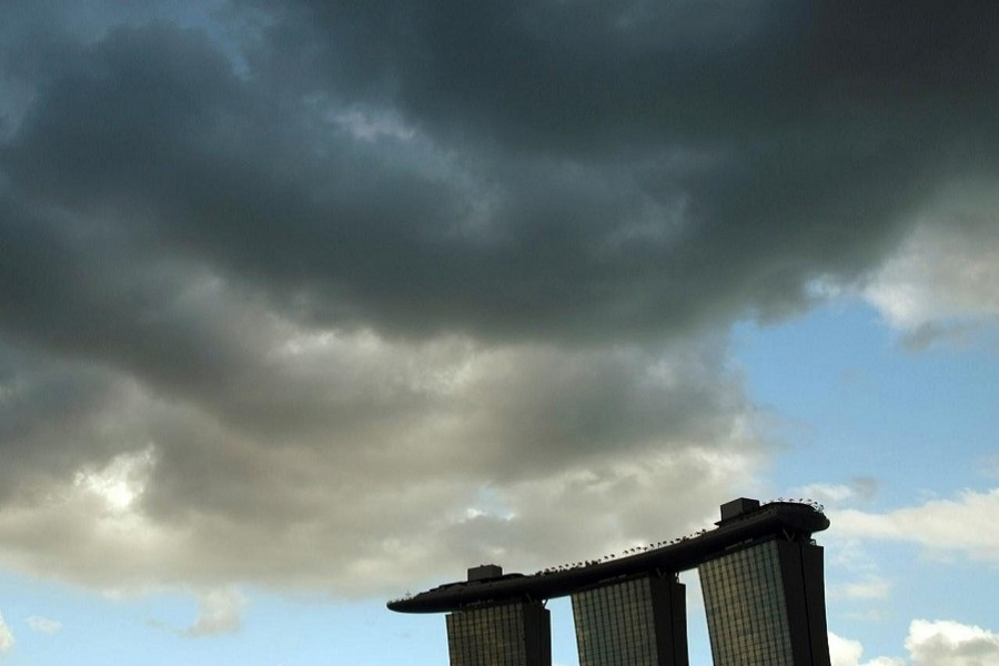 Clouds are seen above the Marina Bay Sands resort in Singapore, January 24, 2011. — Reuters/Files