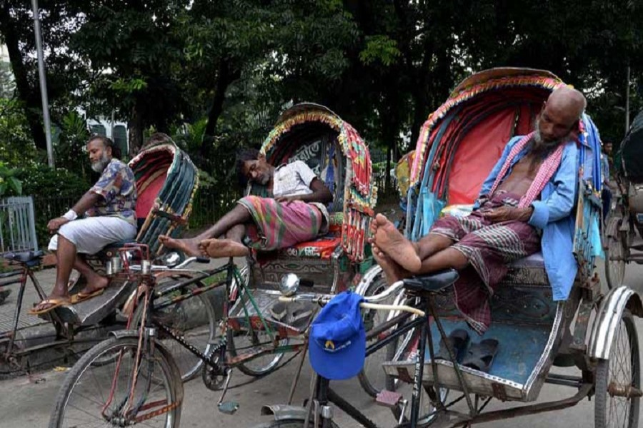 Three rickshaw-pullers taking rest at an unspecified location in the city on June 26, 2018, when the summer heat is at its peak. — UNB/Files