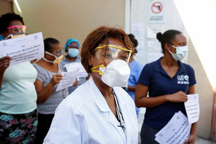 Medical staff display signs after the director of the hospital, surgeon Jerry Bitar, was kidnapped, as Haiti battles an outbreak of the coronavirus disease (COVID-19) amid a spike in gang violence, in Port-au-Prince, Haiti on March 27, 2020 — Reuters photo