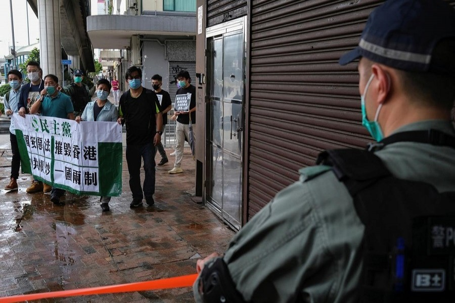 Activists march against new security laws, near China's Liaison Office, in Hong Kong, China May 22, 2020. — Reuters