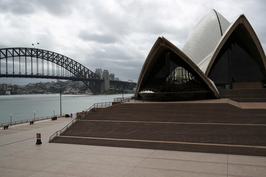 People are seen on the nearly deserted steps of the Sydney Opera House in Australia, March 26, 2020 — Reuters/Files