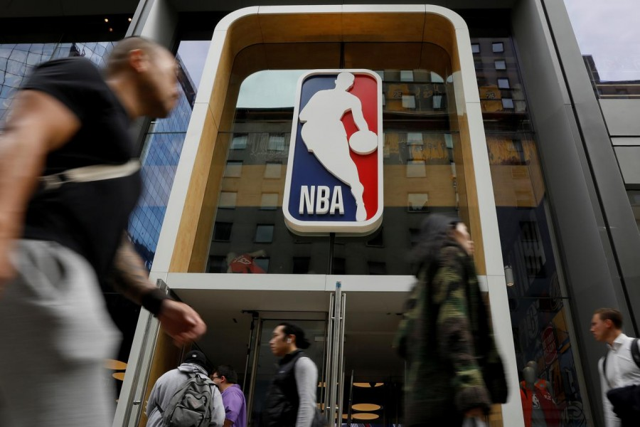 The NBA logo is displayed as people pass by the NBA Store in New York City, US on October 7, 2019 — Reuters/Files