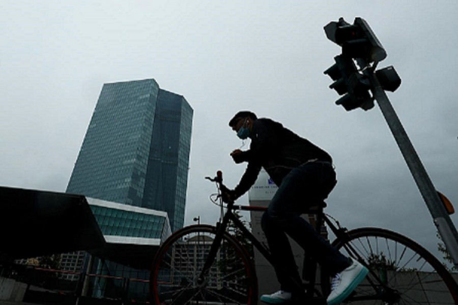 A man cycles towards the European Central Bank (ECB) headquarters in Frankfurt, Germany, July 08, 2020 — Reuters/Files