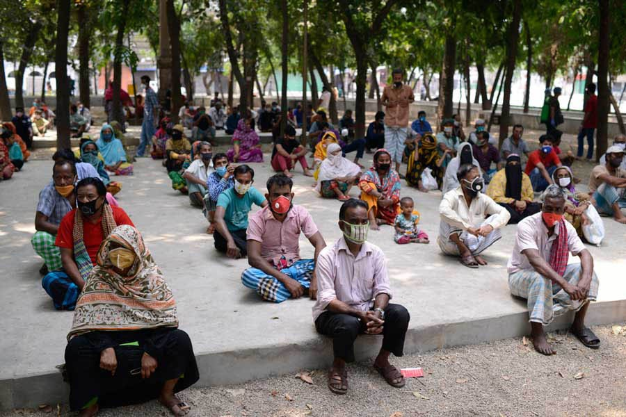 People waiting for relief supplies provided by local community in Dhaka a few months ago—Al Jazeera Photo