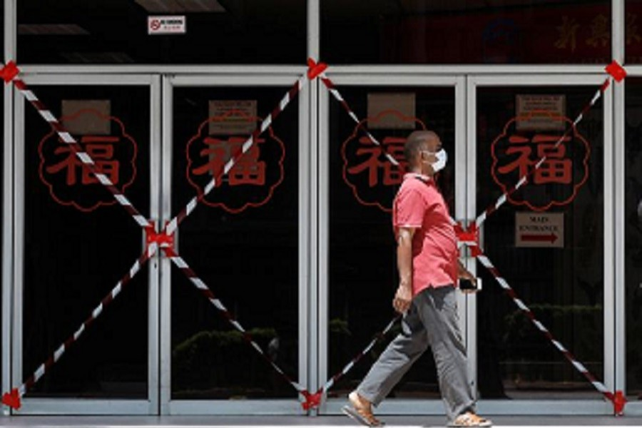 A man passes a closed off mall amid the coronavirus disease (Covid-19) outbreak in Singapore, May 26, 2020 — Reuters/Files