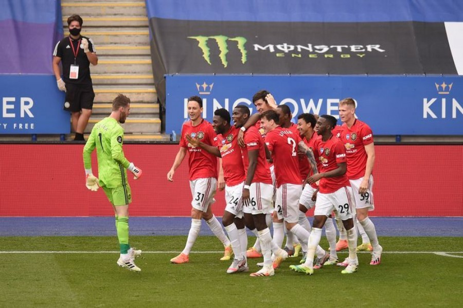 Soccer Football - Premier League - Leicester City v Manchester United - King Power Stadium, Leicester, Britain - July 26, 2020 Manchester United's Jesse Lingard celebrates scoring their second goal with teammates, as play resumes behind closed doors following the outbreak of the coronavirus disease (COVID-19) Pool via REUTERS/Oli Scarff
