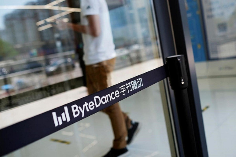 People walk past a logo of Bytedance, the China-based company which owns the short video app TikTok, or Douyin, at its office in Beijing, China, July 07, 2020 — Reuters/Files