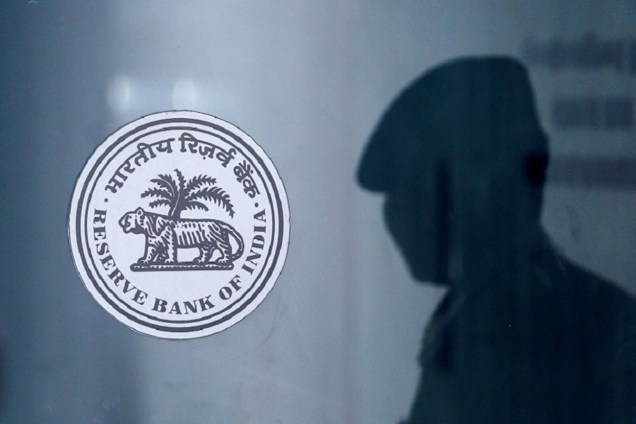 A security guard's reflection is seen next to the logo of the Reserve Bank Of India (RBI) at the RBI headquarters in Mumbai, India, June 6, 2019 — Reuters/Files