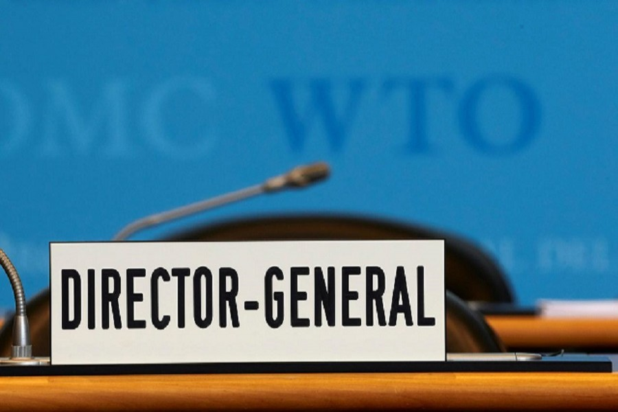 A sign is pictured in front of the chair of the Director General before the start of the General Council of the World Trade Organization (WTO) in Geneva, Switzerland, July 22, 2020. REUTERS/Denis Balibouse