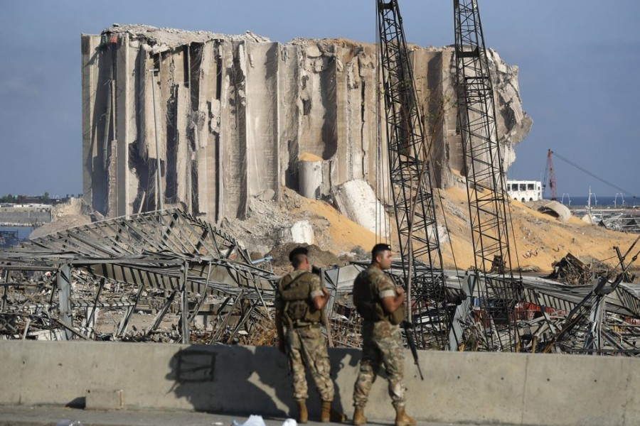 Lebanese army soldiers stand guard at the scene where an explosion hit on Tuesday the seaport of Beirut, Lebanon on Thursday, August 6, 2020 — AP Photo