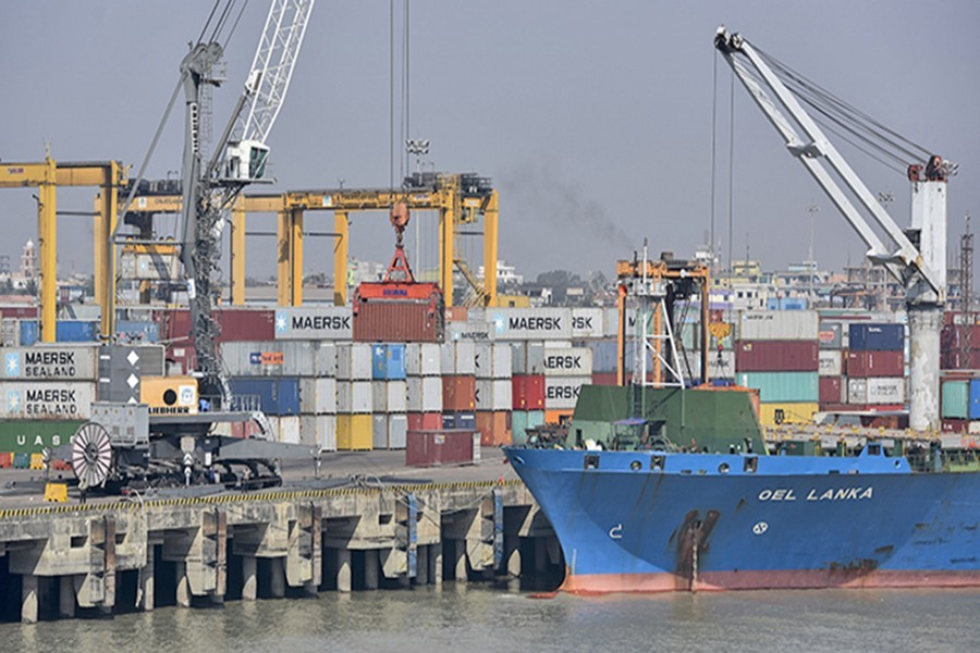 Containers being unloaded from a freighter at Chittagong Port — file photo