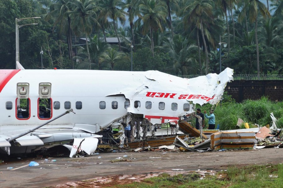 Officials inspect the site where a passenger plane crashed when it overshot the runway at the Calicut International Airport in Karipur, in Kerala, India, August 08, 2020 — Reuters