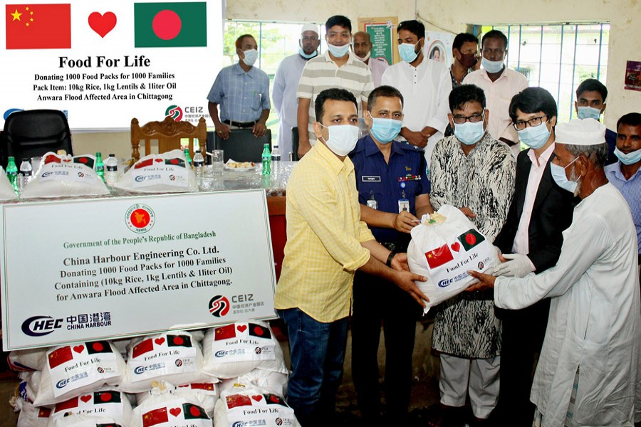 China Harbour distributes foodstuff for the flood victims at Anwara