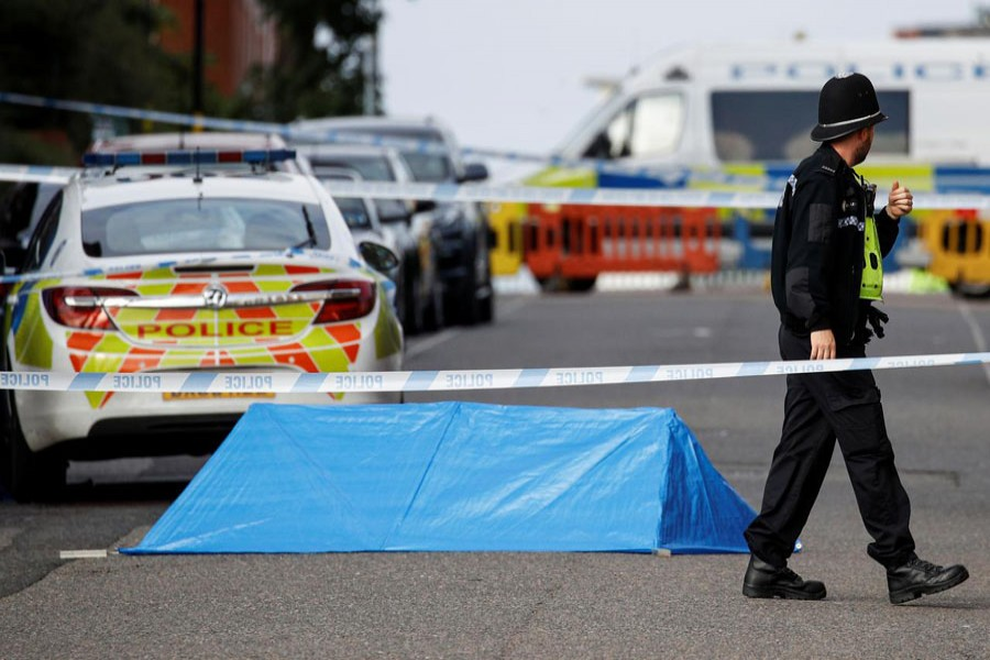 A police officer is seen near the scene of reported stabbings in Birmingham, Britain, September 06, 2020. REUTERS/Phil Noble