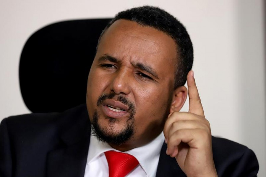 FILE PHOTO: Jawar Mohammed, an Oromo activist and leader of the Oromo protest speaks during a Reuters interview at his house in Addis Ababa, Ethiopia October 23, 2019. REUTERS/Tiksa Negeri/File Photo