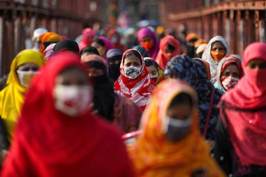 Garment workers returning from a workplace as factories reopened after the government has eased the restrictions amid concerns over the coronavirus disease (Covid-19) outbreak in Dhaka, Bangladesh on May 4, 2020 — Reuters Photo