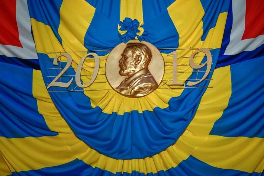 The flags of Sweden and Norway draped around a copy of the Nobel Prize medal at the Nobel award ceremony are pictured at Stockholm Concert Hall, in Stockholm, Sweden on December 10, 2019