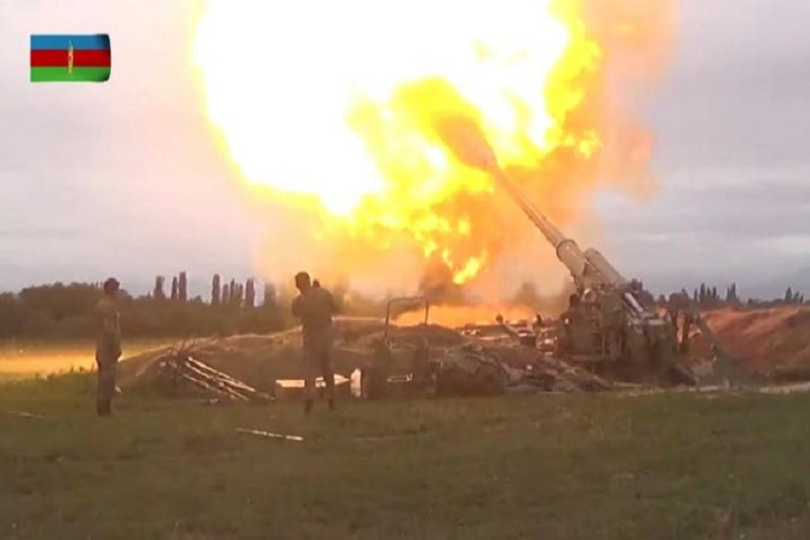 A still image from a video released by the Azerbaijan's Defence Ministry shows members of Azeri armed forces firing artillery during clashes between Armenia and Azerbaijan over the territory of Nagorno-Karabakh in an unidentified location, in this still image from footage released September 28, 2020 —Defence Ministry of Azerbaijan/Handout via Reuters