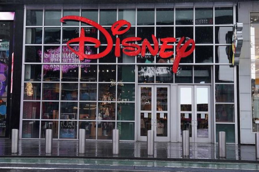 A closed Disney store is pictured in Times Square following the outbreak of coronavirus disease (COVID-19), in the Manhattan borough of New York City, New York, US, March 23, 2020. REUTERS/Carlo Allegri