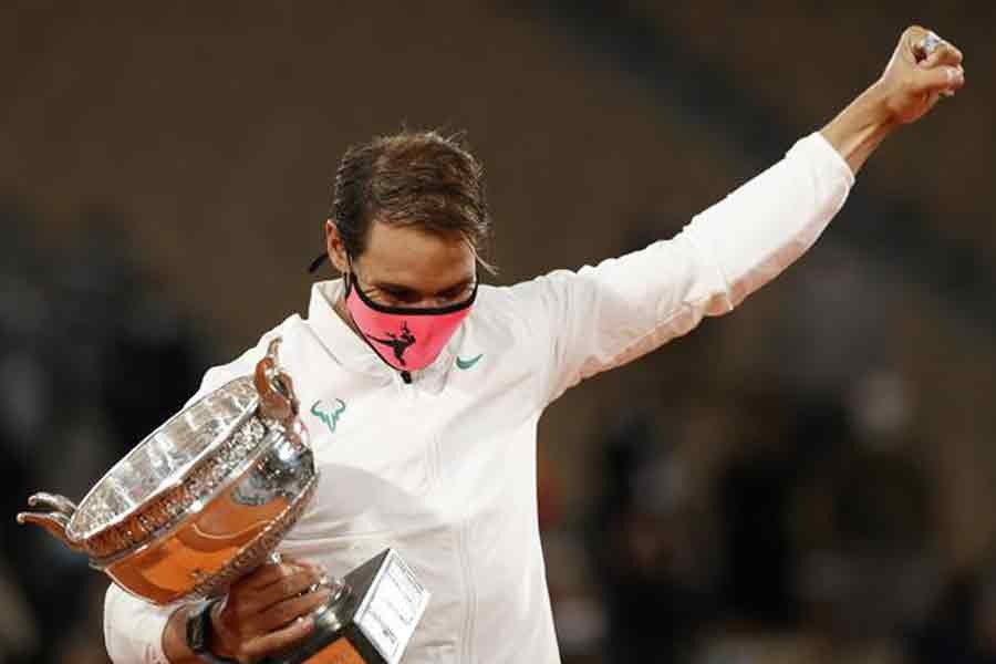 Rafael Nadal celebrating with the trophy after winning the French Open final against Serbia's Novak Djokovic on Sunday –Reuters Photo