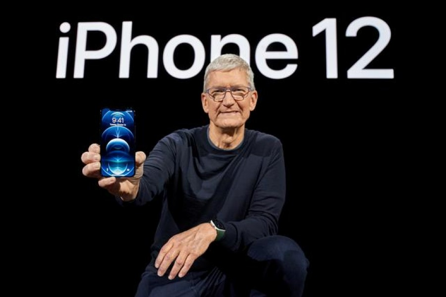 Apple CEO Tim Cook poses with the all-new iPhone 12 Pro at Apple Park in Cupertino, California, U.S. in a photo released October 13, 2020. Brooks Kraft/Apple Inc./Handout via REUTERS