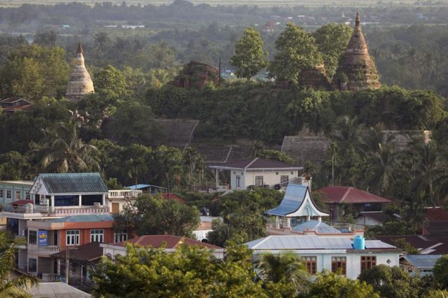 A landscape view of the downtown with ancient pagodas in the background in Mrauk U, Rakhine state, Myanmar June 28, 2019. REUTERS/Ann Wang/File Photo