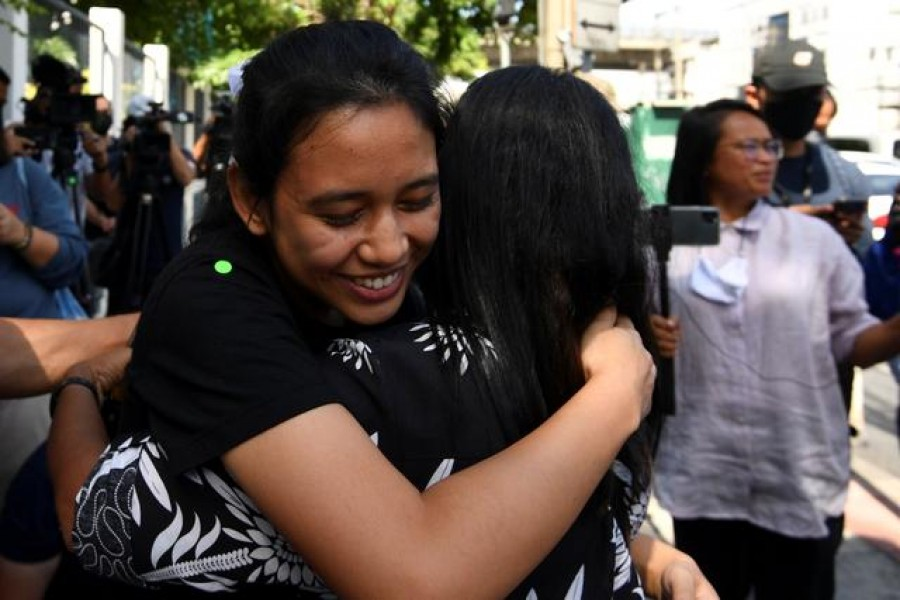 "One of Thailand's protest leaders, Patsaravalee ""Mind"" Tanakitvibulpon reacts after she was freed on bail, in Bangkok Thailand October 22, 2020. REUTERS/Chalinee Thirasupa"