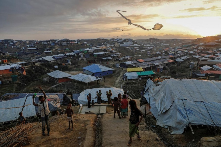 Rohingya refugee children fly improvised kites at the Kutupalong refugee camp near Cox's Bazar, Bangladesh, December 10, 2017 — Reuters/Files
