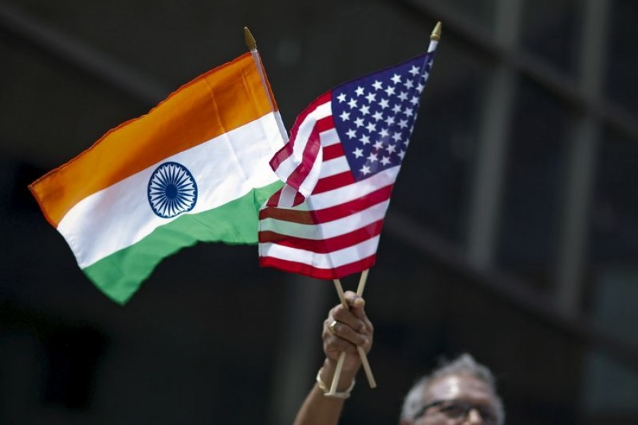 A man holds the flags of India and the US while people take part in the 35th India Day Parade in New York, US on August 16, 2015 — Reuters/Files