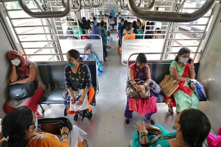 Women wearing protective face masks commute in a suburban train after authorities resumed the train services for women passengers during non-peak hours, amidst the coronavirus disease (Covid-19) outbreak, in Mumbai, India on October 21, 2020 — Reuters photo
