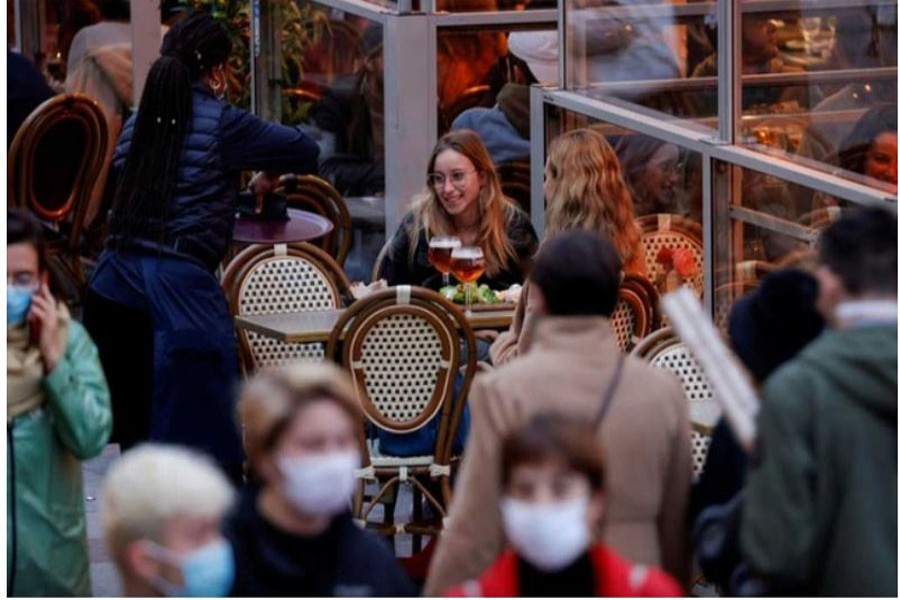 People sit at bar terraces and enjoy their beers before the late-night curfew due to restrictions against the spread of the coronavirus disease (COVID-19) in Lille, France, Oct 16, 2020. REUTERS