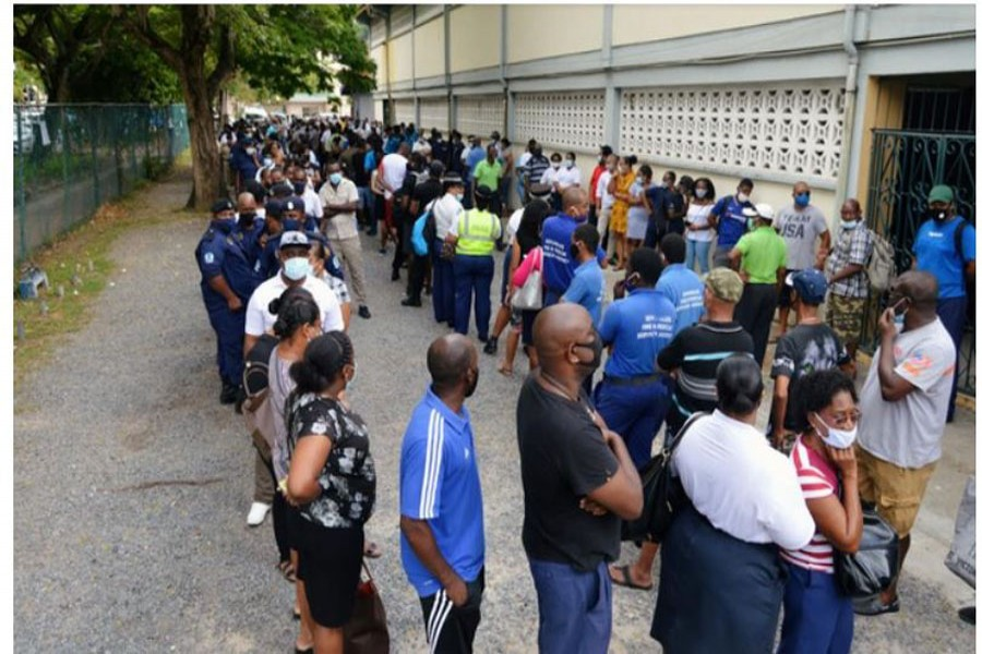 Voters queue at a polling station to cast their ballots during the presidential and parliamentary elections in Victoria, English River, Seychelles, Oct 22, 2020. REUTERS