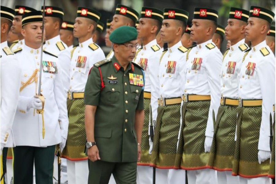 Malaysia's King, Al-Sultan Abdullah Ri'ayatuddin Al-Mustafa Billah Shah, inspects an honour guard during the 62nd Merdeka Day (Independence Day) celebrations in Putrajaya, Malaysia, August 31, 2019. Reuters