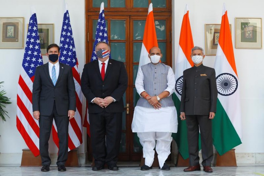 US Secretary of State Mike Pompeo, US Secretary of Defense Mark Esper pose for a picture with India's Foreign Minister Subrahmanyam Jaishankar and India's Defence Minister Rajnath Singh during a photo opportunity ahead of their meeting at Hyderabad House in New Delhi, India, October 27, 2020 — Reuters