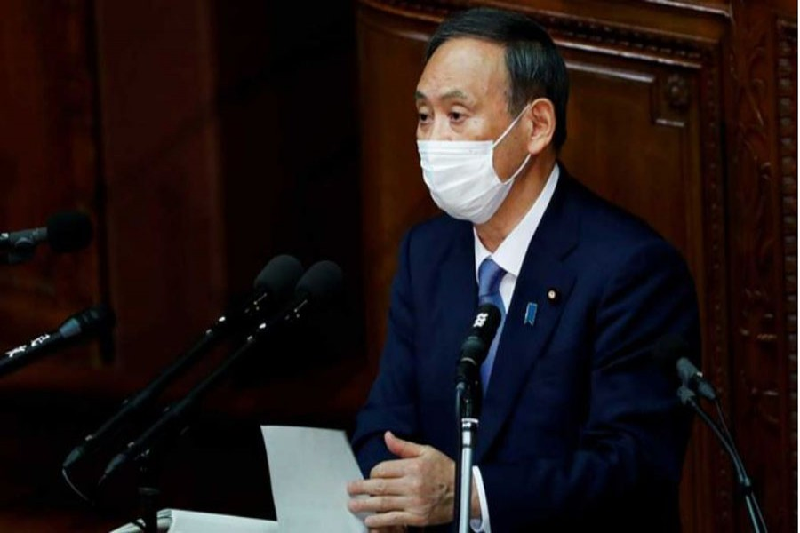 Japanese Prime Minister Yoshihide Suga gives his first policy speech in parliament as an extraordinary session opens in Tokyo, Japan Oct 26, 2020. REUTERS