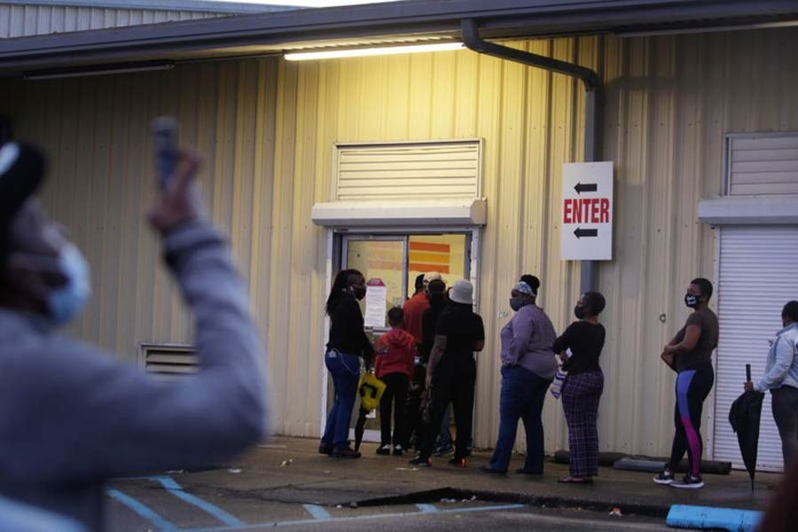 People line up to cast their ballot for the upcoming presidential election as early voting ends as tropical storm Zeta approaches the Gulf Coast in New Orleans, Louisiana, US, recently –Reuters Photo