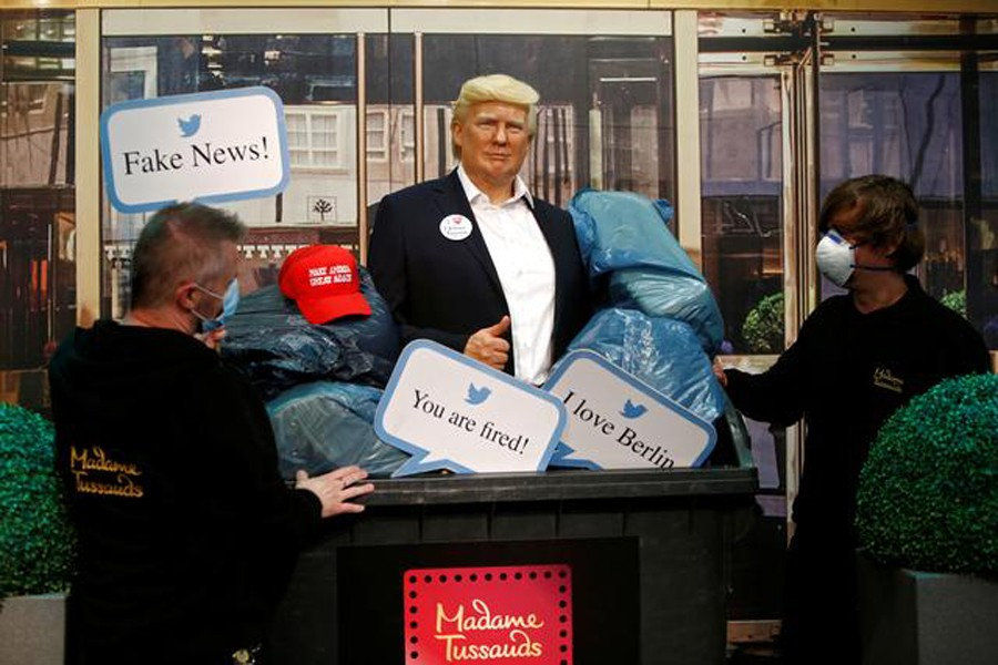 A wax figure depicting US President Donald Trump is put into a dumpster at Madame Tussauds in Berlin, Germany on October 30, 2020 — Reuters photo