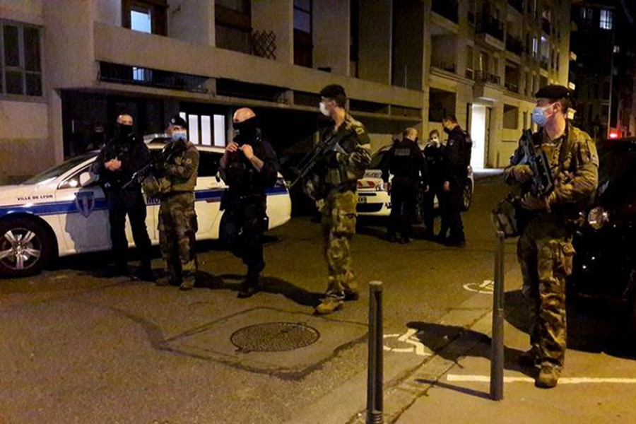 Police secures a street after a Greek Orthodox priest was shot and injured at a church in the centre of Lyon, France, October 31, 2020 -- Reuters