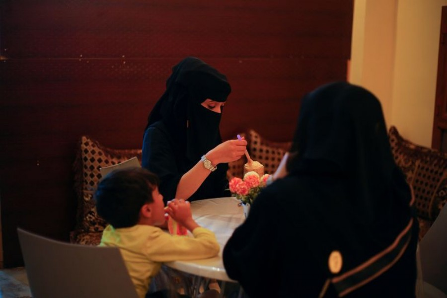 Women and a boy sit in the only all-female internet cafe in Marib, Yemen October 13, 2020 — Reuters/Files