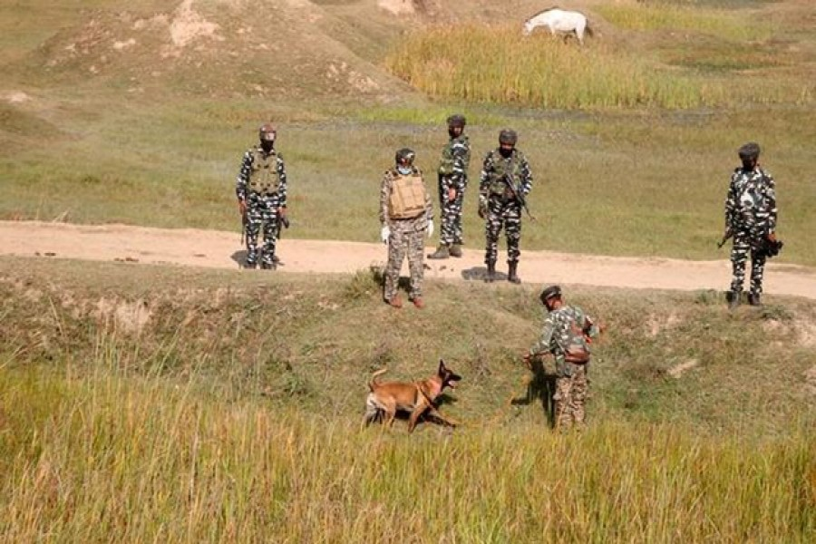 Indian security force personnel with their sniffer dog stand during a search operation after suspected militants attacked a Central Reserve Police Force (CRPF) patrolling party near Pampore, on the outskirts of Srinagar, October 5, 2020 — Reuters/Files