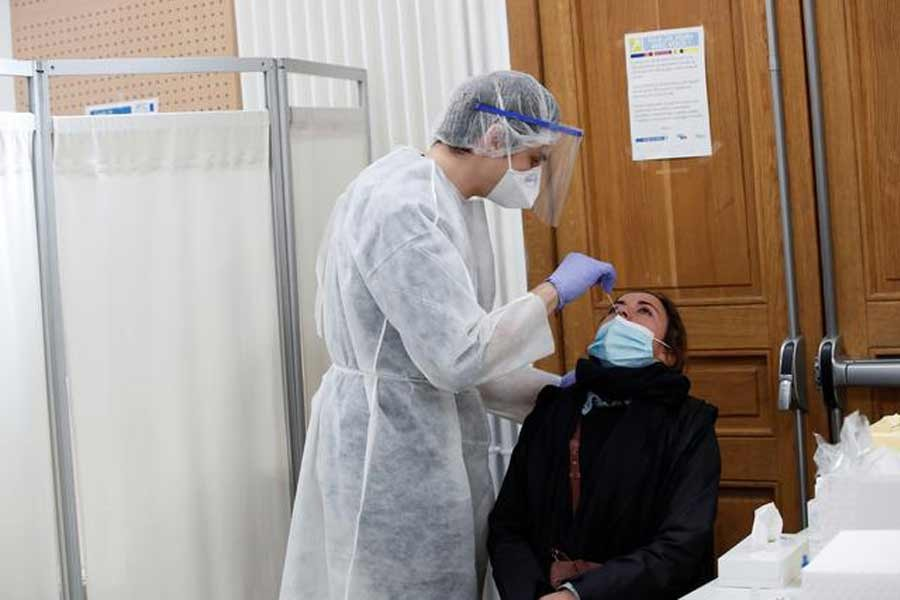 A health worker taking a swab samples from a person at a Covid-19 testing centre in Paris last month –Reuters Photo