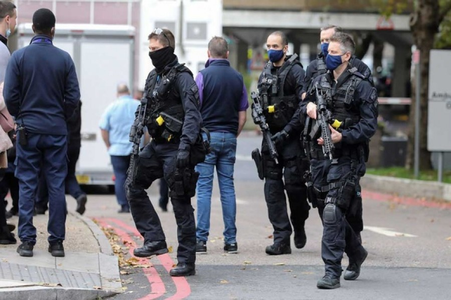 Police officers are seen at St Thomas' Hospital, in London, Britain October 13, 2020. Reuters