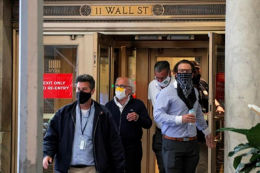 Traders exit the 11 Wall St. door of the New York Stock Exchange (NYSE) in New York City, New York, US, June 26, 2020 — Reuters