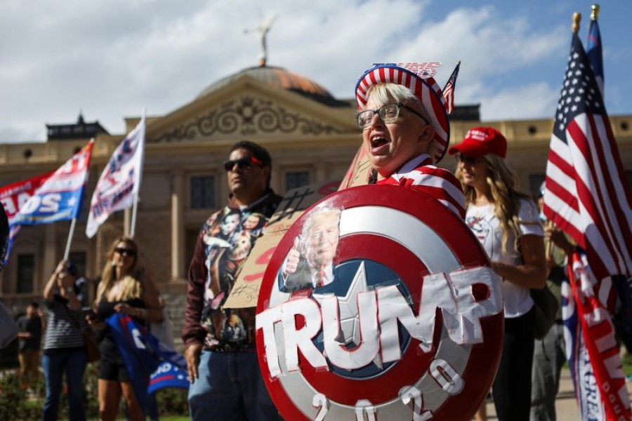"""Supporters of US President Donald Trump gather at a """"Stop the Steal"""" protest after the 2020 US presidential election was called for Democratic candidate Joe Biden, in front of the Arizona State Capitol in Phoenix, Arizona, US, November 7, 2020. REUTERS/Jim Urquhart"""