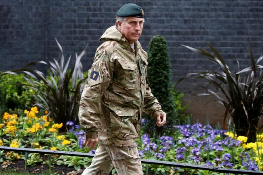 FILE PHOTO: British Army General Sir Nick Carter arrives for a meeting to address the government's response to the coronavirus outbreak, at Downing Street in London, Britain March 12, 2020. REUTERS/Henry Nicholls