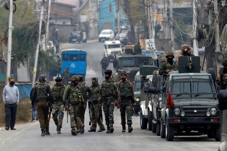Indian soldiers leave a gun battle site after a suspected militant commander was killed in a gun battle between Indian security forces and suspected militants, at Rangreth on the outskirts of Srinagar, November 1, 2020. Reuters