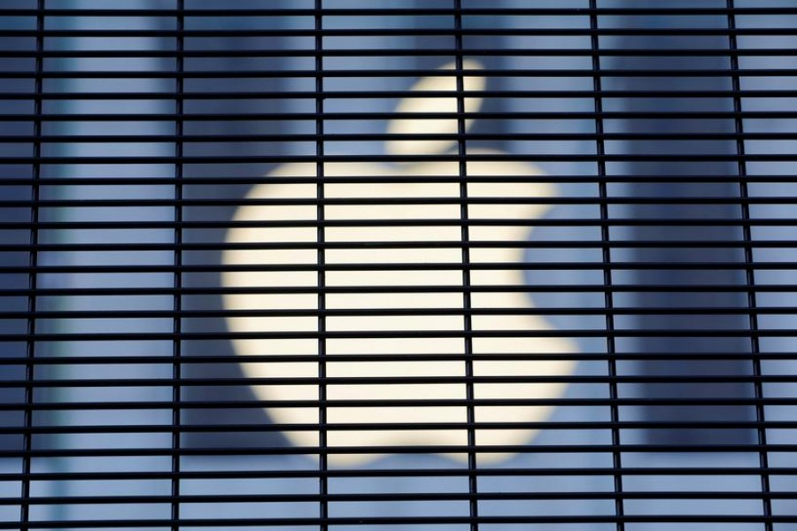 The Apple logo is seen through a security fence erected around the Apple Fifth Avenue store in Manhattan, New York City, US on November 5, 2020 —Reuters/Files